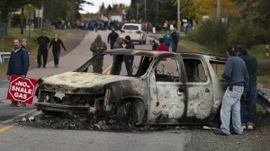 A burned out RCMP  vehicle at the site of the police assault on the anti-fracking protest in New Brunswick on Oct 17, 2013.
