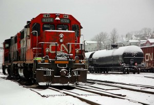 CN locomotive and oil wagons on the shore of Halifax harbour, photo Flikr Commons