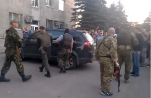 Residents of the town of Krasnoarmeysk in eastern Ukraine confront fascist gang that has come into their town. The fascists killed two people.