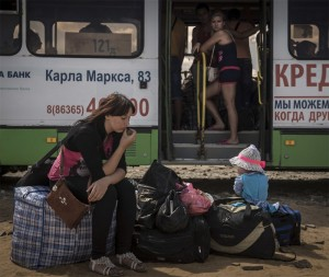 Bus departing to Russia from a refugee camp in Donetsk, Aug 2014, photo NYT