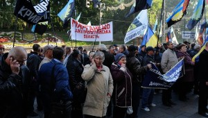 Refugees from war in eastern Ukraine protest in Kyiv on Oct 19, demanding housing and other assistance, phone RIA Novosti