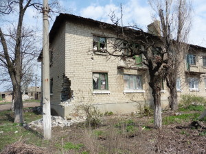 Shelling damage from summer 2014 warfare in rural Donetsk near Russian border (photo by Roger Annis)