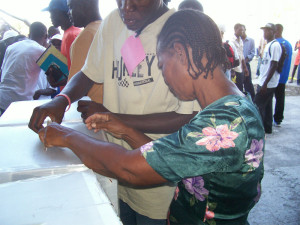 Casting ballots in Haiti, photo by IJDH