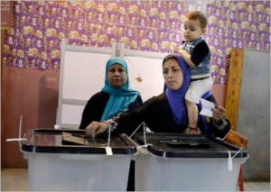 A woman casts her vote in Cairo on Oct 18, 2015 in military-run Parliament election (Amr Nabi, AP)