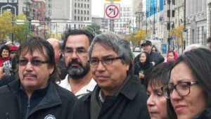 James Anaya, center, is greeted in Winnipeg, Oct 12, 2013