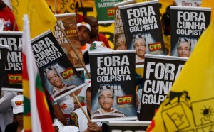Anti-impeachment march in Sao Paulo, Brazil on Dec 16, 2015. Placards say 'Out with coupmaker Cunha' (Andre Penner, AP)