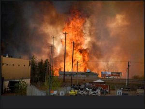 Wildfire burns city of Fort McMurray, Alberta on May 3, 4, 2016 (Tim Fortin, Flikr Commons)