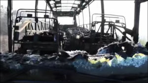 One of the buses of Crimean citizens attacked and burned by Ukrainian rightists at Korsun, Ukraine in Feb 2014 (screenshot from film 'The pogrom of Korsun')