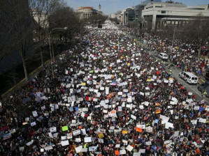 Demonstrators in Washington and across the United States mourn those lost to gun violence and condemn complicit politicians