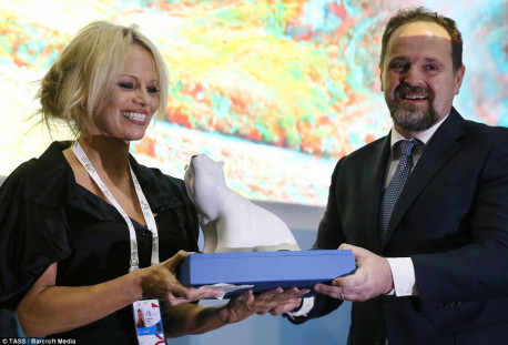 Speaking at economic forum in Russia, Pamela Anderson warns of the world's threatened ecology and mistreatment of animals
