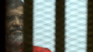 ​Another court in Egypt convicts president overthrown in July 2013 military coup